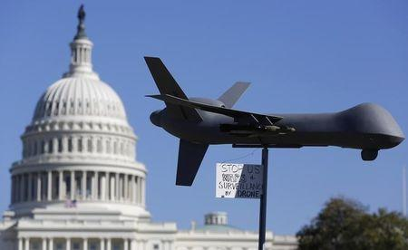 """Demonstrators deploy model of U.S. drone aircraft at """"Stop Watching Us: A Rally Against Mass Surveillance"""" near U.S. Capitol in Washington"""