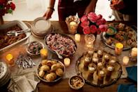"""<p>Hosting your friends and family for the holidays doesn't have to break the bank. This delicious, crowd-pleasing party menu is simple, fun, and easy on your wallet.</p><p><strong>Appetizers:</strong><br><a href=""""https://www.countryliving.com/food-drinks/recipes/a3262/roasted-winter-squash-soup-recipe/"""" rel=""""nofollow noopener"""" target=""""_blank"""" data-ylk=""""slk:Roasted Winter Squash Soup"""" class=""""link rapid-noclick-resp"""">Roasted Winter Squash Soup</a></p><p><a href=""""https://www.countryliving.com/food-drinks/recipes/a3263/pigs-in-blanket-recipe/"""" rel=""""nofollow noopener"""" target=""""_blank"""" data-ylk=""""slk:Pigs in Blankets"""" class=""""link rapid-noclick-resp"""">Pigs in Blankets</a></p><p><a href=""""https://www.countryliving.com/food-drinks/recipes/a3265/pulled-pork-biscuits-recipe/"""" rel=""""nofollow noopener"""" target=""""_blank"""" data-ylk=""""slk:Pulled Pork in Biscuits"""" class=""""link rapid-noclick-resp"""">Pulled Pork in Biscuits</a></p><p><a href=""""https://www.countryliving.com/food-drinks/recipes/a3264/smoky-popcorn-recipe/"""" rel=""""nofollow noopener"""" target=""""_blank"""" data-ylk=""""slk:Smoky Popcorn"""" class=""""link rapid-noclick-resp"""">Smoky Popcorn</a></p><p><a href=""""https://www.countryliving.com/food-drinks/recipes/a3293/spicy-rosemary-peanuts-recipe/"""" rel=""""nofollow noopener"""" target=""""_blank"""" data-ylk=""""slk:Spicy Rosemary Peanuts"""" class=""""link rapid-noclick-resp"""">Spicy Rosemary Peanuts</a></p><p><strong>Dessert:</strong><br><a href=""""https://www.countryliving.com/food-drinks/recipes/a3287/mini-bread-puddings-recipe/"""" rel=""""nofollow noopener"""" target=""""_blank"""" data-ylk=""""slk:Mini Bread Puddings"""" class=""""link rapid-noclick-resp"""">Mini Bread Puddings</a></p><p><strong>Trio of Cocktails:</strong> <br><a href=""""https://www.countryliving.com/food-drinks/recipes/a3295/cranberry-cava-cocktails-recipe/"""" rel=""""nofollow noopener"""" target=""""_blank"""" data-ylk=""""slk:Cranberry Cava Cocktail"""" class=""""link rapid-noclick-resp"""">Cranberry Cava Cocktail</a></p><p><a href=""""https://www.countryliving.com/food-drinks/recipes/a3291/tropical-bourbon-pun"""