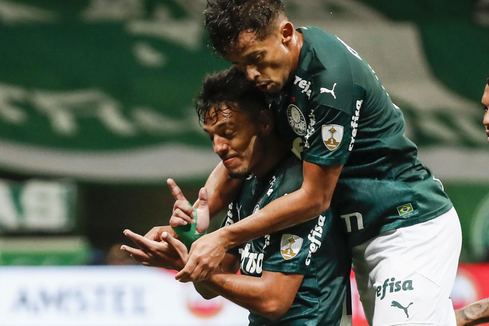Brazil's Palmeiras Gabriel Menino (L) celebrates after scoring against Paraguay's Libertad during their Copa Libertadores quarterfinal football match at the Allianz Parque stadium in Sao Paulo, Brazil, on December 15, 2020. (Photo by Sebastiao Moreira / POOL / AFP) (Photo by SEBASTIAO MOREIRA/POOL/AFP via Getty Images)