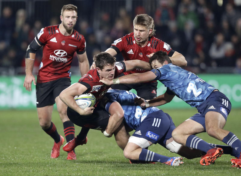Crusaders George Bridge is tackle day the Blues defence during the Super Rugby Aotearoa rugby game between the Crusaders and the Blues in Christchurch, New Zealand, Saturday, July 11, 2020. (AP Photo/Mark Baker)