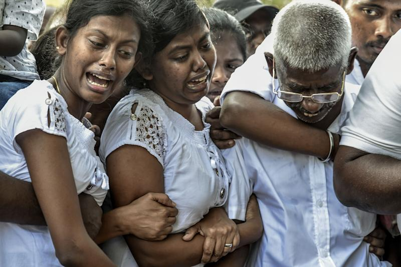 COLOMBO, SRI LANKA - APRIL 24: Relatives cry at the graveside during the funeral of a victim of the Easter Sunday Bombings at a local cemetery on April 24, 2019 in Colombo, Sri Lanka. At least 359 people were killed and 500 people injured after coordinated attacks on churches and hotels on Easter Sunday which rocked three churches and three luxury hotels in and around Colombo as well as at Batticaloa in Sri Lanka. According to reports, police have identified eight out of nine attackers on Wednesday as the Islamic State group claimed responsibility for the attacks. Police have detained 60 suspects so far in connection with the suicide bombs while the countrys government blame the attacks on local Islamist group National Thowheed Jamath (NTJ). (Photo by Atul Loke/Getty Images) ORG XMIT: 775332412 ORIG FILE ID: 1139044170