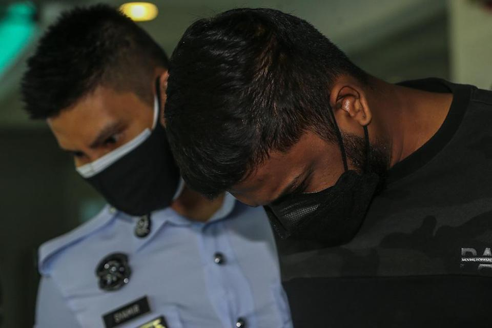 Devaaswin Krishnan arrives at the Shah Alam High Court to be charged with the murder of two youths following a fatal accident along Federal Highway on September 12. — Picture by Yusof Mat Isa
