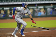 Texas Rangers' Joey Gallo drops his bat after hitting a RBI ground-rule double against the Houston Astros during the ninth inning of a baseball game Wednesday, Sept. 16, 2020, in Houston. (AP Photo/David J. Phillip)