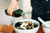 """<p>Oil gets a bad rap for being full of fat. While you don't want to drench your foods in the stuff, oil is the good kind of fat that can be healthy for you. Of course, it depends on which type you're using: """"Some oils are better than others in terms of the type of fats each is made up of, as well as the level of processing needed to extract it,"""" John Fawkes, NSCA-certified personal trainer, Precision Nutrition certified nutritionist, and managing editor at <a href=""""https://the-unwinder.com/"""" rel=""""nofollow noopener"""" target=""""_blank"""" data-ylk=""""slk:The Unwinder"""" class=""""link rapid-noclick-resp"""">The Unwinder</a>, explains. <br></p><p>When you need oil, opt for olive oil, flaxseed oil, or avocado oil. """"Each is high in heart-healthy monounsaturated fatty acids, lower in polyunsaturated fats, and generally available in cold-pressed varieties that don't reduce beneficial compounds through heated extraction,"""" Fawkes says. <br></p>"""