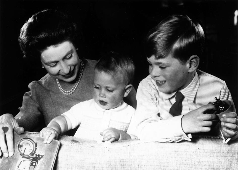 Queen Elizabeth plays with Princes Edward and Andrew at Windsor Castle in June 1965.