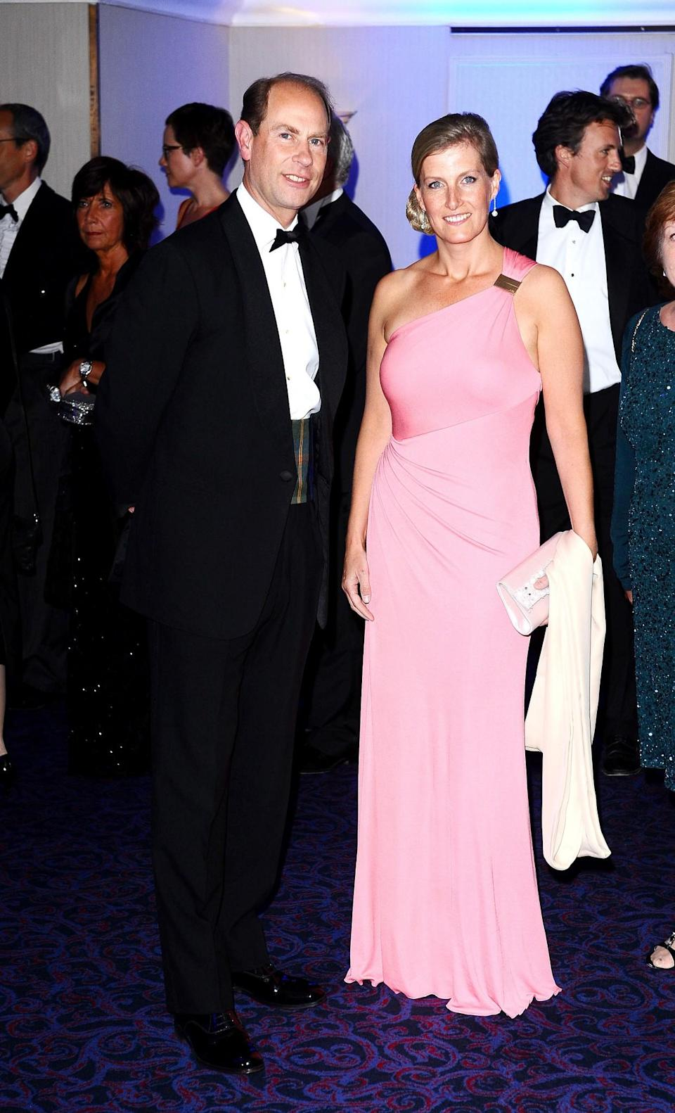 <p>Super-feminine in a dusty pink gown at the Grosvenor House Hotel in September 2012[Photo: PA] </p>