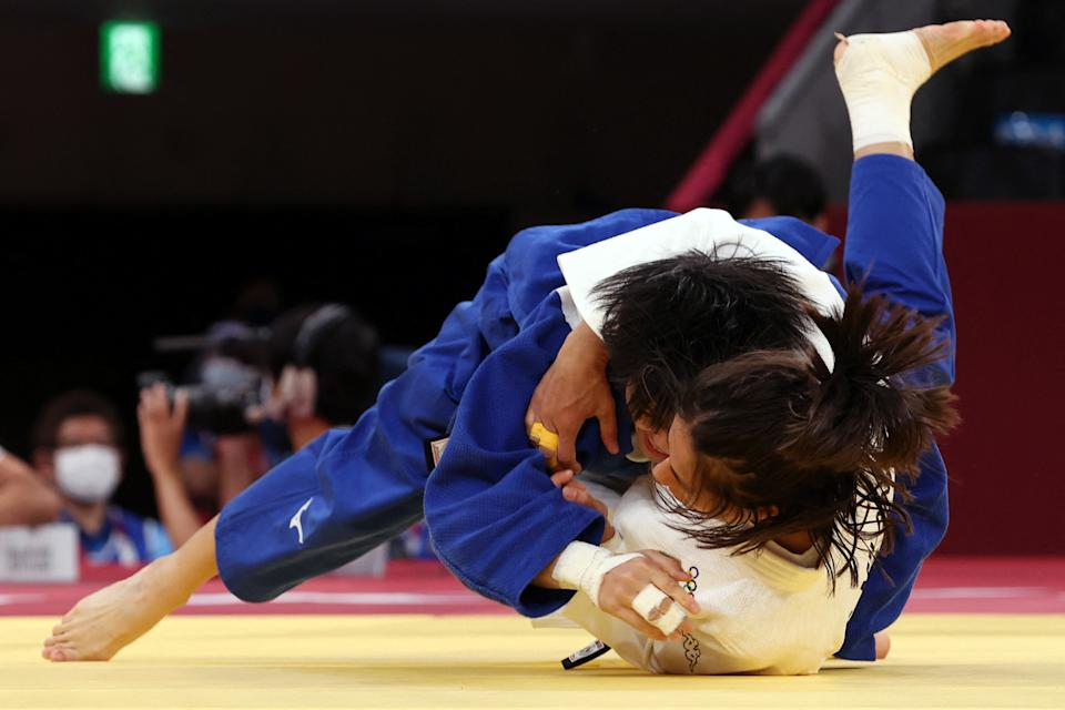 Italy's Francesca Milani (white) competes with Taiwan's Chen-Hao Lin during their judo women's -48kg elimination round bout during the Tokyo 2020 Olympic Games at the Nippon Budokan in Tokyo on July 24, 2021. / AFP / Jack GUEZ