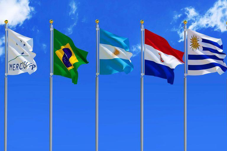 MERCOSUR flag Silk waving flags MERCOSUR Brazil Argentina Paraguay Uruguay Venezuela five members with a flagpole on a sunny blue sky background with white clouds 3D illustration