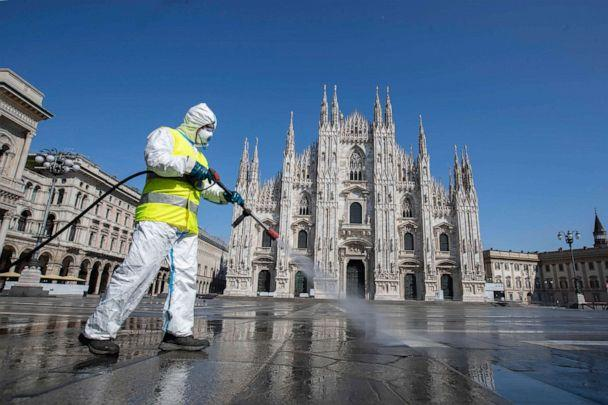 PHOTO: In this file photo taken on March 31, 2020, a worker sprays disinfectant to sanitize Piazza del Duomo, the main city square of Milan, Italy. (Luca Bruno/AP)