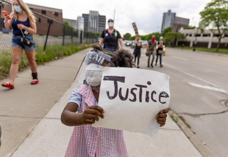 Laylah, 5, marches down Michigan Ave. on June 4, 2020 in Detroit. (Sylvia Jarrus / for NBC News)