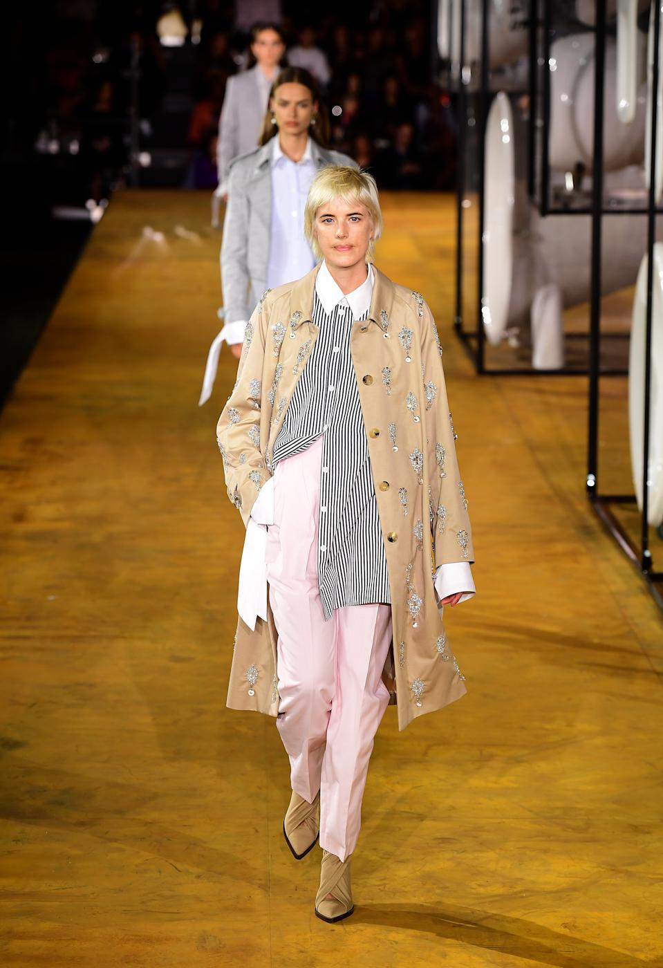 Agyness Deyn walked the catwalk in pink trousers, a striped skirt and trench coat. [Photo: PA]