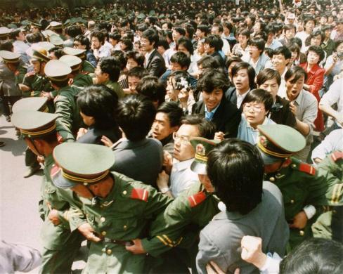 Crowds of jubilant students surge through a police cordon before pouring into Tiananmen Square, June 4, 1989.