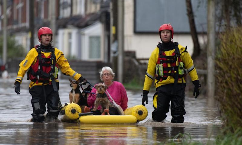 A woman and her dogs are rescued from a property in Nantgarw, Wales.