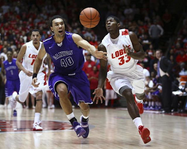Grand Canyon's Blake Davis (40) races to to ball against New Mexico guard Deshawn Delaney (33) during the first half of an NCAA college basketball game in Albuquerque, N.M., Monday, Dec. 23, 2013. (AP Photo/Juan Antonio Labreche)
