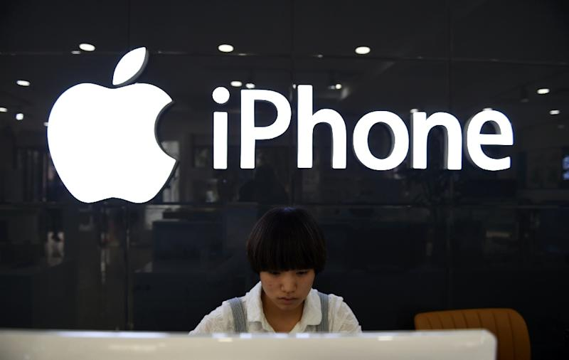 "Apple said iPhone sales in China would be lower than forecast due to steeper than expected ""economic deleration"" (AFP Photo/Greg Baker)"