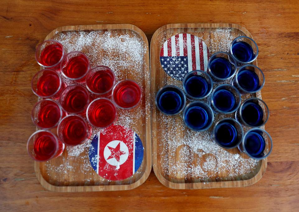 Special red and blue shots offered at Escobar bar to mark the summit meeting between U.S. President Donald Trump and North Korean leader Kim Jong Un. (REUTERS/Edgar Su/File Photo)
