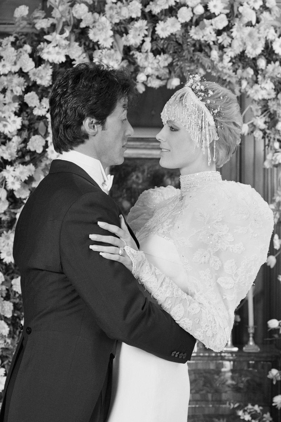 <p>No one did '80s glam better than Brigitte Nielson, especially at her wedding to Sylvester Stallone in December 1985. She designed the long-sleeved gown herself and added a statement-making beaded headdress on top.</p>