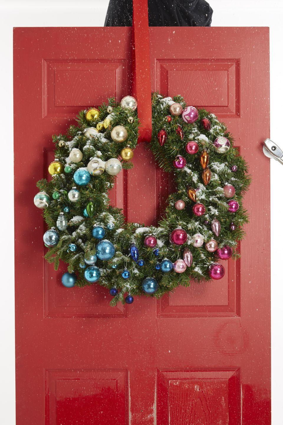"<p>A faux wreath provides the basis for this sweet decoration. Group ornaments by color, placing warm shades (pink, red, orange, yellow, gold) on one side and cool tones (blue, purple, green, silver) on the other. </p><p><strong>RELATED:</strong> <a href=""https://www.goodhousekeeping.com/holidays/christmas-ideas/how-to/g2203/christmas-decoration-ideas/"" rel=""nofollow noopener"" target=""_blank"" data-ylk=""slk:80+ Christmas Decoration Ideas to Turn Your Home Into a Winter Wonderland"" class=""link rapid-noclick-resp"">80+ Christmas Decoration Ideas to Turn Your Home Into a Winter Wonderland</a></p>"