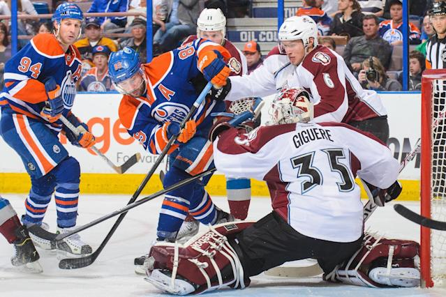 Sam Gagner of the Edmonton Oilers takes a shot on Jean-Sebastien Giguere of the Colorado Avalanche during an NHL game at Rexall Place on April 8, 2014 in Edmonton (AFP Photo/Derek Leung)