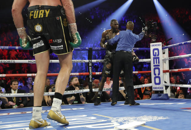 Referee Kenny Bayless calls for the doctor as he holds Deontay Wilder seconds after stopping the heavyweight title fight with Tyson Fury Saturday at the MGM Grand Garden at 1:39 of the seventh round. (Steve Marcus/Reuters)