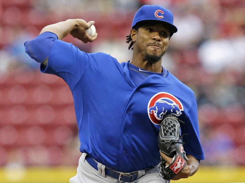 Chicago Cubs starting pitcher Edwin Jackson throws against the Cincinnati Reds in the first inning of a baseball game on Wednesday, April 30, 2014, in Cincinnati. (AP Photo)