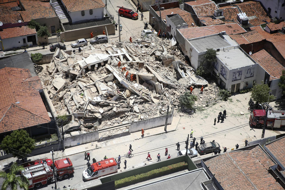 Firefighters search for survivors after a building collapsed in Fortaleza, Ceara state, Brazil, Tuesday, Oct. 15, 2019. A seven-story building collapsed Tuesday in an upscale part of the Brazilian city of Fortaleza, killing one person and leaving others trapped with some communicating with family members by cellphone from under debris, officials said. (Jose Leomar/Diario do Nordeste via AP)