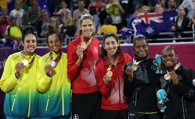 Beach Volleyball - Gold Coast 2018 Commonwealth Games - Women's Medal Ceremony - Coolangatta Beachfront - Gold Coast, Australia - April 12, 2018. Gold medalists Sarah Pavon and Melissa Humana-Paredes of Canada, silver medalists Taliqua Clancy and Mariafe Artacho Del Solar of Australia and bronze medalists Miller Pata and Linline Matauatu of Vanuatu pose. REUTERS/Athit Perawongmetha