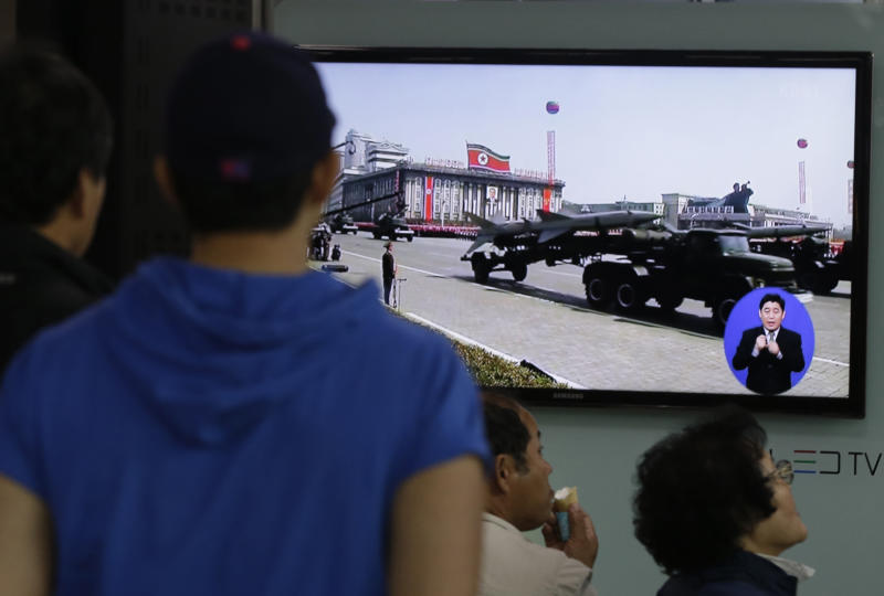 South Koreans watch TV news showing a footage of North Korean missiles on a military parade, at a Seoul Train Station in Seoul, South Korea, Saturday, May 18, 2013. North Korea fired three short-range guided missiles into its eastern waters on Saturday, a South Korean official said. It routinely tests such missiles, but the latest launches came during a period of tentative diplomacy aimed at easing tensions. (AP Photo/Ahn Young-joon)