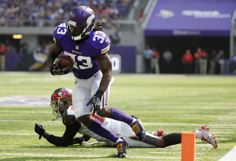 Minnesota Vikings running back Dalvin Cook (33) runs from Tampa Bay Buccaneers cornerback Vernon Hargreaves, rear, during the first half of an NFL football game, Sunday, Sept. 24, 2017, in Minneapolis. (AP Photo/Bruce Kluckhohn)