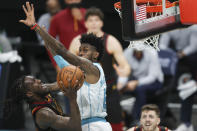Cleveland Cavaliers forward Taurean Prince, left, shoots against Charlotte Hornets forward Jalen McDaniels during the second quarter of an NBA basketball game in Charlotte, N.C., Wednesday, April 14, 2021. (AP Photo/Nell Redmond)