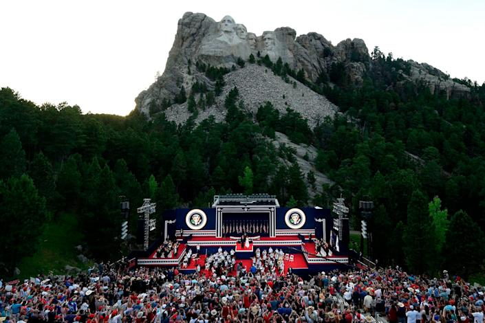 US President Donald Trump and First Lady Melania Trump arrive onstage during an Independence Day event at Mount Rushmore in Keystone, South Dakota, July 3, 2020.