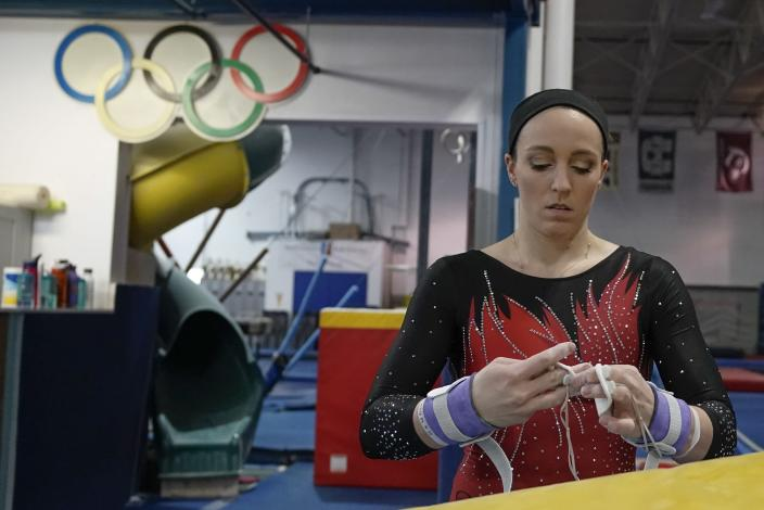 Former gymnastics world champion and Olympic silver medalist Chellsie Memmel works out Thursday, Feb. 18, 2021, in New Berlin, Wisc. The 32-year-old married mother of two is making an unlikely comeback. (AP Photo/Morry Gash)