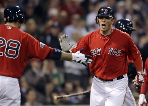 Boston Red Sox's Ryan Sweeney, right, is congratulated by Adrian Gonzalez after scoring on a hit by Dustin Pedroia in the second inning of a baseball game against the Cleveland Indians at Fenway Park in Boston, Friday, May 11, 2012. (AP Photo/Charles Krupa)