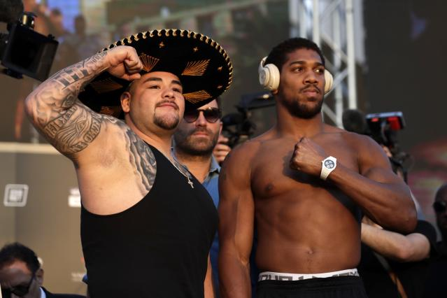 Anthony Joshua (R) and Andy Ruiz Jr. pose after the weigh-in on Friday at Faisaliah Center in Riyadh, Saudi Arabia. Ruiz defends his heavyweight titles vs. Joshua on Saturday. (AP Photo/Hassan Ammar)