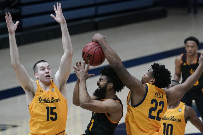 Arizona State guard Remy Martin, center left, tries to shoot between California forward Grant Anticevich (15), forward Andre Kelly (22) and guard Makale Foreman (10), as Kelly gets a hand and forearm on the ball during the first half of an NCAA college basketball game in Berkeley, Calif., Thursday, Dec. 3, 2020. (AP Photo/Jeff Chiu)