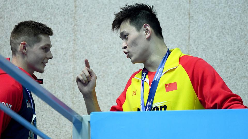 Sun Yang is seen here confronting Duncan Scott at the 2019 swimming world championships.
