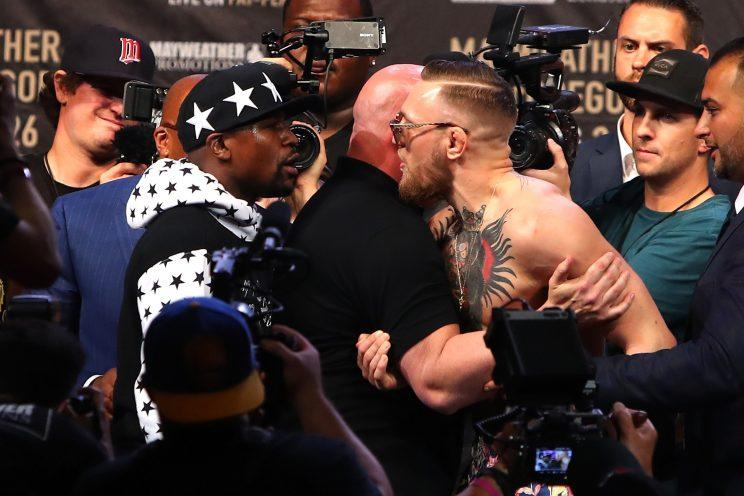 Floyd Mayweather Jr. and Conor McGregor face off during New York stop of their media tour. (Getty)