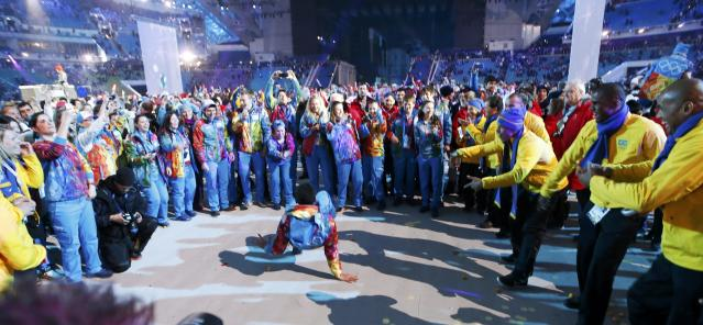A participant break dances during the party at the end of the closing ceremony for the Sochi 2014 Winter Olympics, February 23, 2014. REUTERS/Marko Djurica (RUSSIA - Tags: SPORT OLYMPICS)