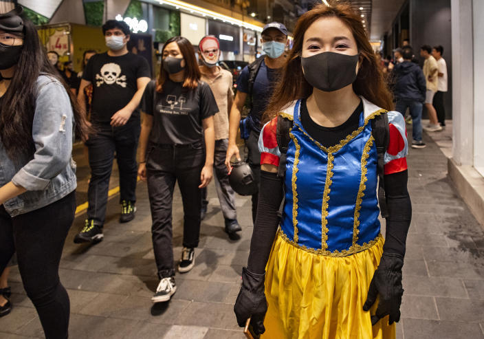 HONG KONG, CHINA - 2019/10/31: A protester dressed as Disney princess wear a black mask during the rally. Protesters at Halloween march in Hong Kong island despite police banned rallies and confront them during the night. (Photo by Miguel Candela/SOPA Images/LightRocket via Getty Images)