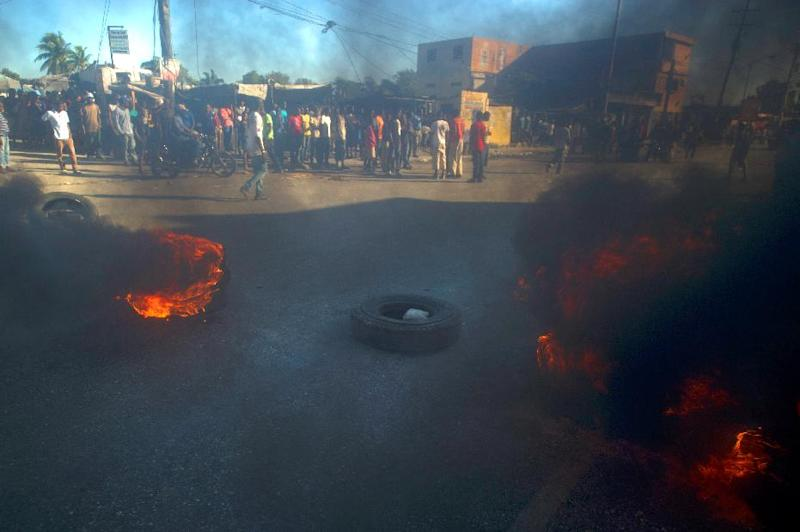 Demonstrators block a street with burning tires during a strike against high oil prices in Port-au-Prince, Haiti on February 2, 2015