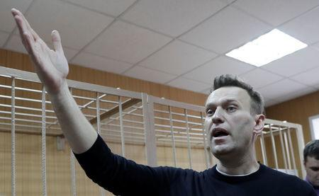 FILE PHOTO: Russian opposition leader Navalny attends hearing after being detained at protest against corruption and demanding resignation of PM Medvedev, at Tverskoi court in Moscow