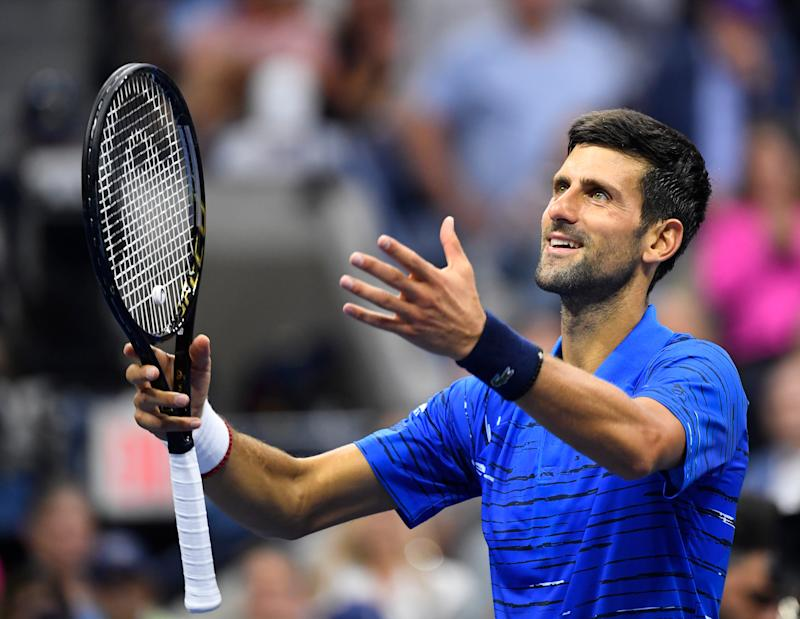 Novak Djokovic fought through shoulder discomfort to advance in straight sets Wednesday. (Getty)