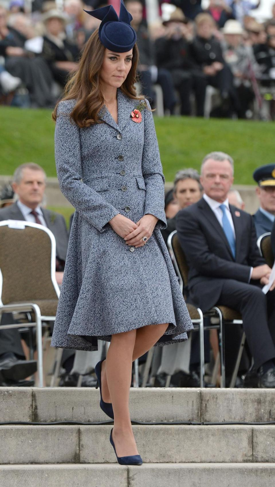 <p>On the final day of the Australian royal tour, Kate wore a jacquard Michael Kors coat and a navy hat by Australian milliner, Jonathan Howard. Other accessories included suede Alexander McQueen heels and the Duchess's trusty Stuart Weitzman clutch. </p><p><i>[Photo: PA]</i></p>