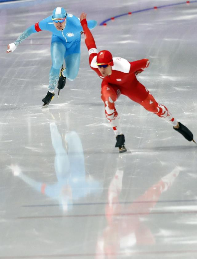 Speed Skating - Pyeongchang 2018 Winter Olympics - Men's 1000m competition finals - Gangneung Oval - Gangneung, South Korea - February 23, 2018 - Piotr Michalski of Poland and Stanislav Palkin of Kazakhstan compete. REUTERS/Phil Noble