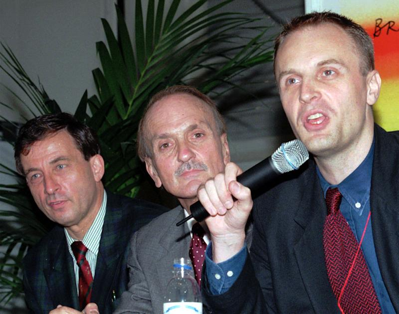 "From right: Richard Horton, editor of the medical journal ""The Lancet"" of U.K., Warren H. Lindner, U.S.A., Senior Advisor to the Chairman and Bernard Hirschel, Swiss Chairman address the press after the end of the 12th World AIDS Conference at Geneva, Switzerland on Friday, July 3,1998.(AP Photo/Donald Stampfli)"