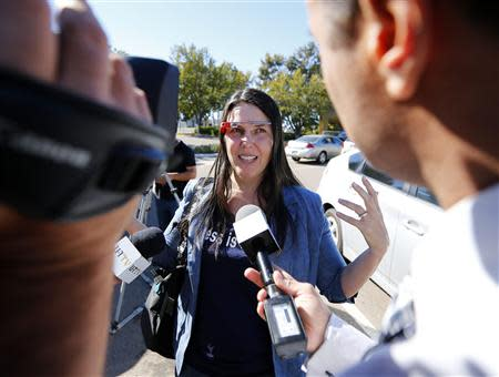 Defendant Cecilia Abadie speaks to the media as she arrives at a traffic court in San Diego January 16, 2014. REUTERS/Mike Blake
