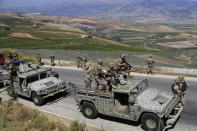 Lebanese army soldiers deploy at the Lebanese side of the Lebanese-Israeli border in the southern village of Kfar Kila, Lebanon, Saturday, May 15, 2021. (AP Photo/Hussein Malla)