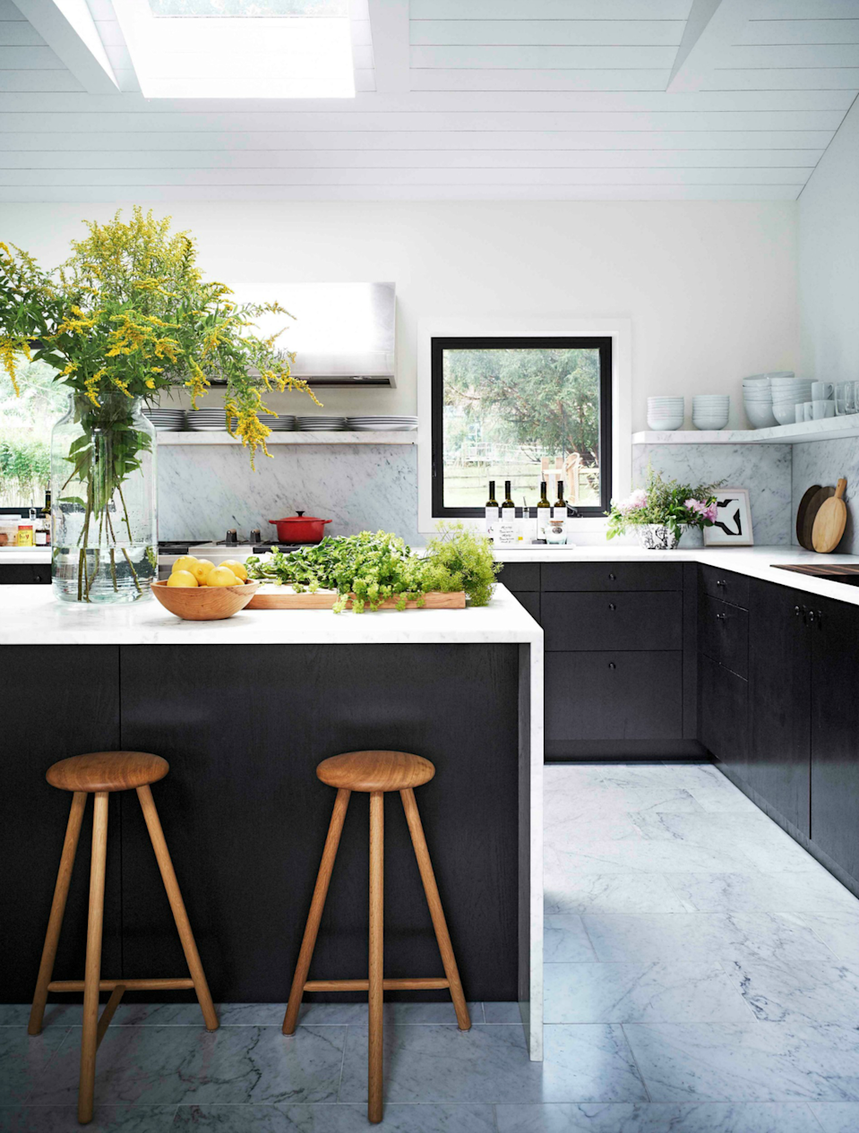 "<p>Don't be afraid to go marble crazy, from the backsplashes to the countertops and even the floors. The slabs of barely gray honed <a href=""https://www.housebeautiful.com/design-inspiration/house-tours/a25647648/maxwell-ryan-apartment-therapy-founder-hamptons-house-tour/"" rel=""nofollow noopener"" target=""_blank"" data-ylk=""slk:Carrara marble"" class=""link rapid-noclick-resp"">Carrara marble</a> covering the kitchen of <a href=""https://www.housebeautiful.com/design-inspiration/house-tours/a25647648/maxwell-ryan-apartment-therapy-founder-hamptons-house-tour/"" rel=""nofollow noopener"" target=""_blank"" data-ylk=""slk:Maxwell Ryan's Hamptons home"" class=""link rapid-noclick-resp"">Maxwell Ryan's Hamptons home </a>make for a clean, airy look. </p>"