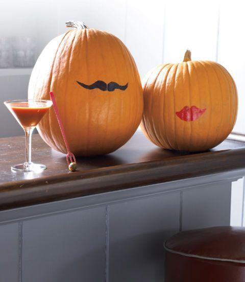 <p>You can use a permanent marker and lipstick to pull off this minimalist pumpkin look that's sure to get you a few compliments. </p>
