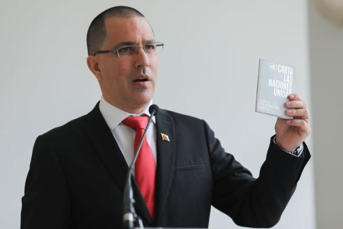 Venezuela's Foreign Minister Jorge Arreaza holds up the United Nations charter as he speaks at the Foreign Ministry headquarters in Caracas